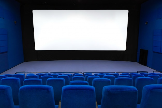Empty of cinema in blue color with white blank screen.