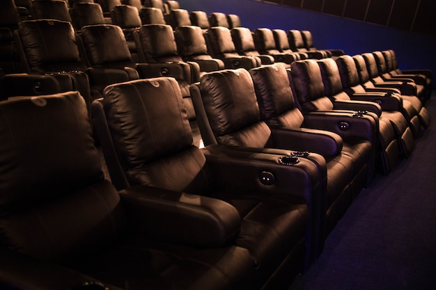 Empty cinema, soft chairs before the premiere film