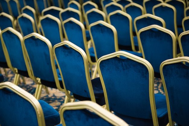 Empty cinema or theater auditorium, chairs befor meeting