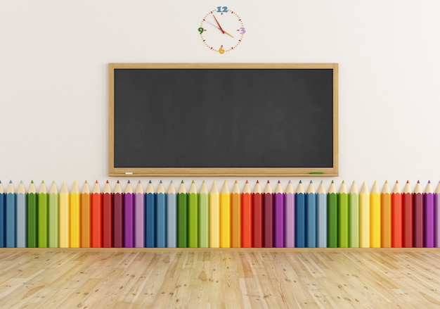 Empty classroom with blackboard and colorful pencil on wall