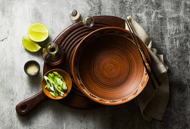 Empty clay dishes. serving set on the table