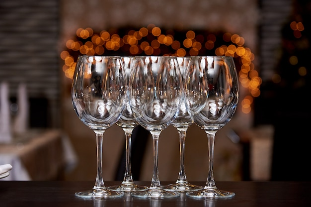 Empty clean glasses with reflection on a blurred background with bokeh.