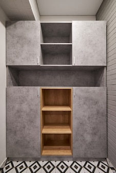 Empty closet for different clothes. a cupboard with shelves. nobody