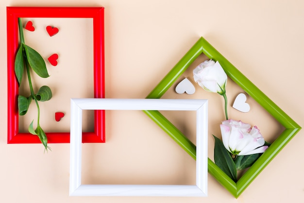 Empty color frames, red hearts and flowers eustoma