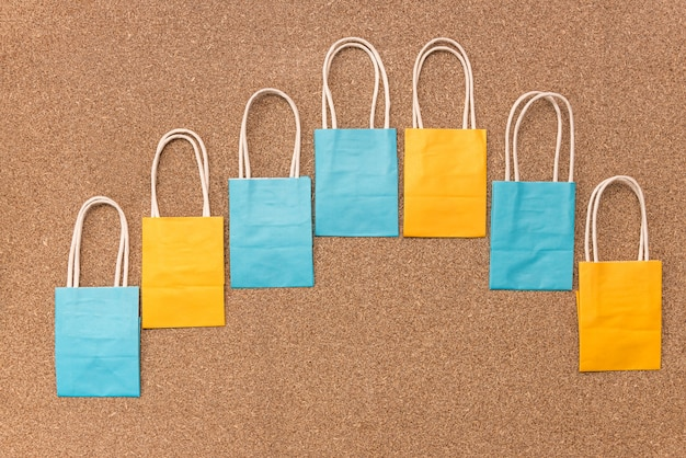 Empty colourful paper packages in curved line