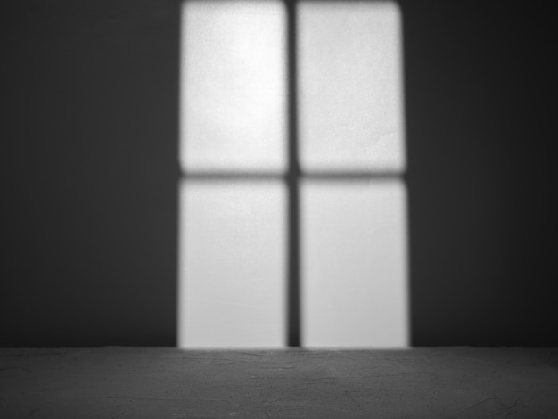 Empty concrete surface with light from window on background