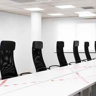 Empty conference room with black chairs