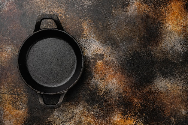 Empty cooking pot set with copy space for text or food with copy space for text or food, top view flat lay, on old dark rustic table background