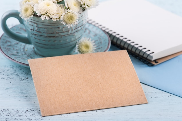 Empty craft envelope with white chrysanthemum