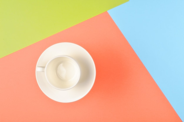 Empty cup on colorful background.
