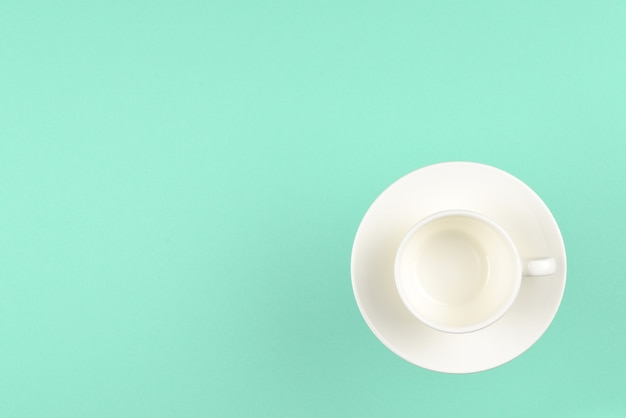 Empty cup on green background. space for text or design.