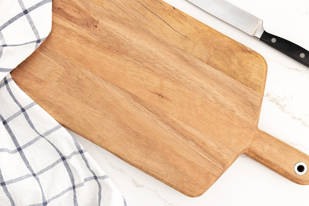 Empty cutting board on white marble background. cuisine kitchen background. mock up