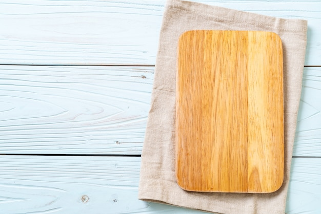 Empty cutting wooden board with kitchen cloth