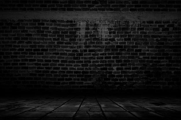 빛과 그림자 스튜디오 배경이 있는 빈 어두운 벽돌 방.