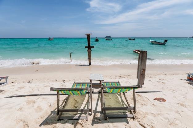 Empty deckchair on the beach in tropical sea