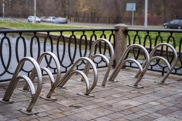 Empty designer street bike parking near public space by the river karpovka in saint petersburg