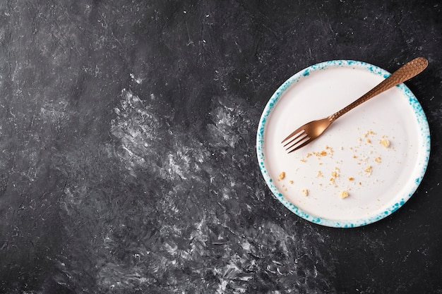 Empty dirty plate and crumbs. top view