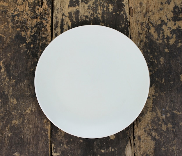Empty dish plate on wooden table
