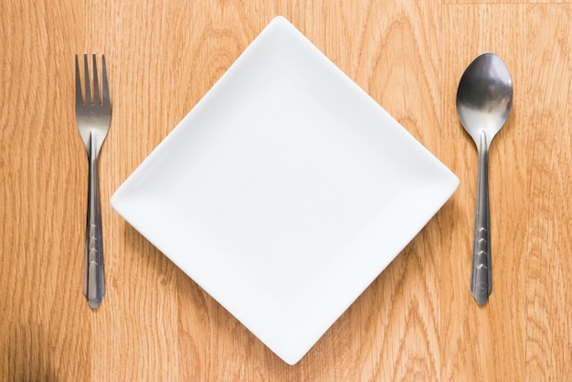Empty dish, spoon and fork