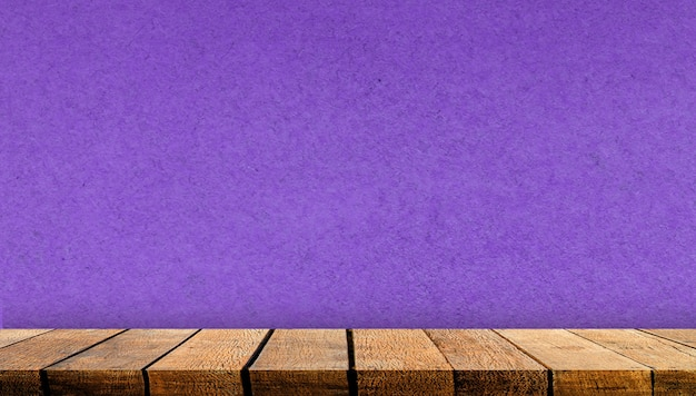 Empty display wooden board shelf table counter with copy space for advertising backdrop and background with purple paper wall background, Premium Photo