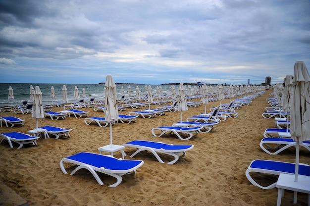 Empty empty beach with folded beach umbrellas