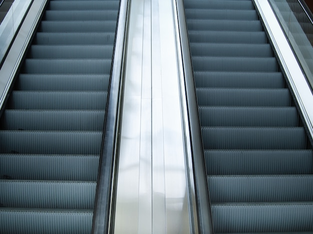 Empty escalator stairs in subway station or shopping mall
