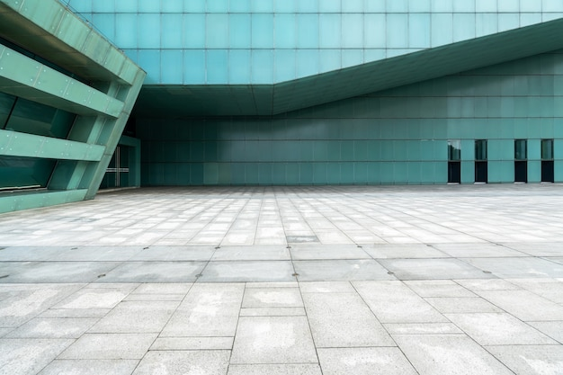 The empty floor of the square and the exterior walls of modern buildings