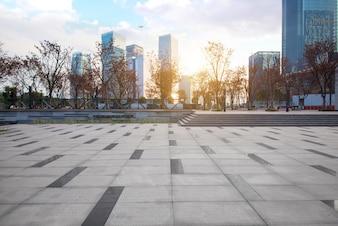 Empty floor with modern skyline and buildings
