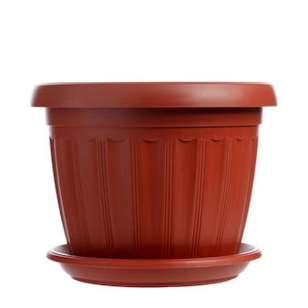 白い表面に分離された空の植木鉢。