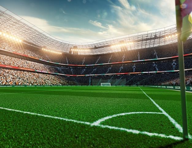 夕方の日光の下で空のサッカースタジアム