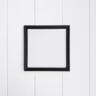 Empty frame over white wood background for mockup