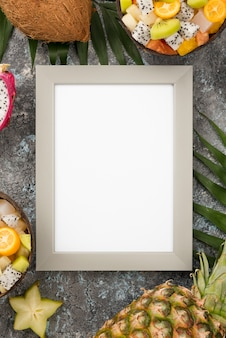 Empty frame surrounded by exotic fruit