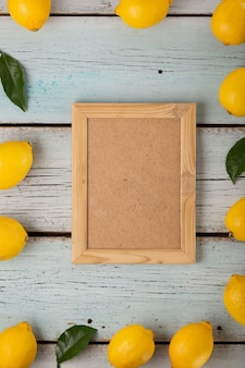 Empty frame for text with lemons and green leaves