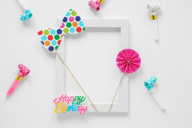 Empty frame with colorful birthday items