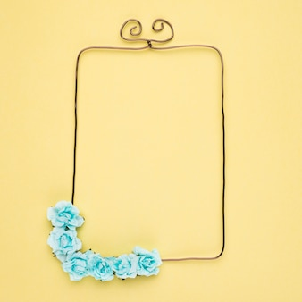 An empty frame with decorative flower on yellow background