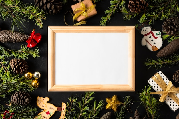 Empty frame with festive christmas ornaments