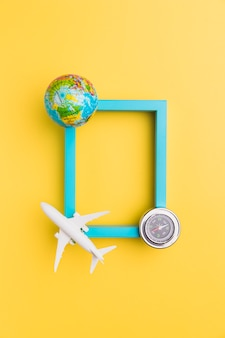 Empty frame with plane and globe