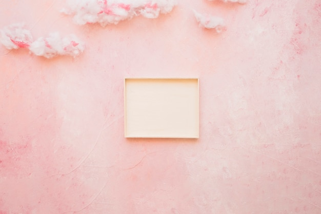 Empty frame with soft cotton wool cloud
