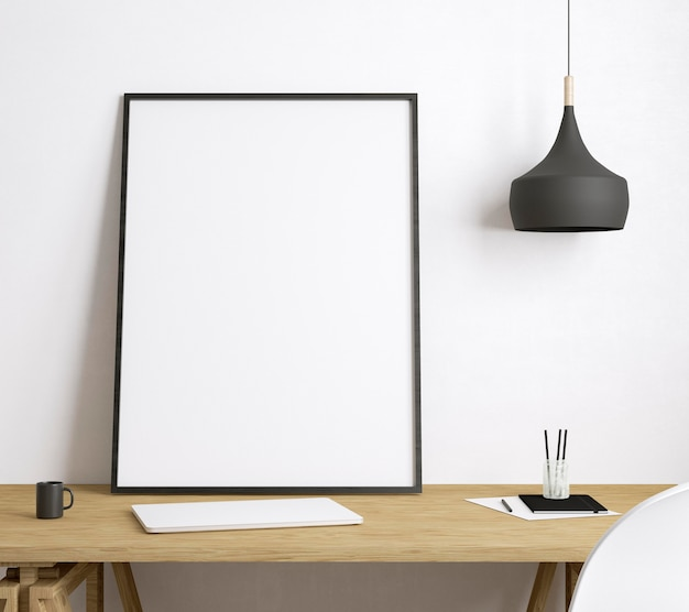 Empty framed canvas on wooden desk