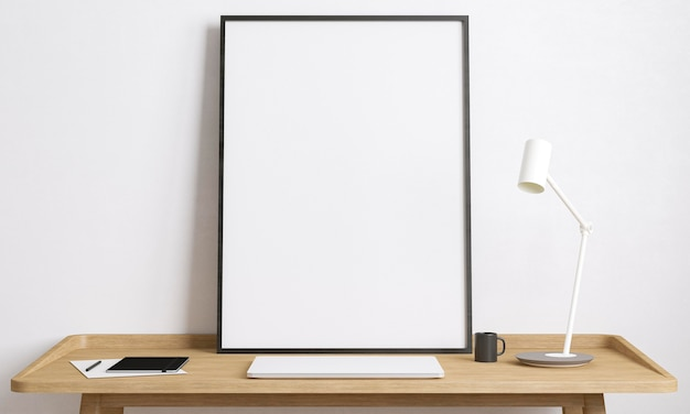 Empty framed canvas on wooden table