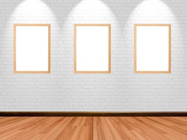 나무 바닥 벽돌 벽 및 스포트 라이트 방 배경에 빈 프레임.