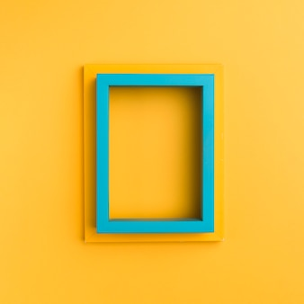 Empty frames on orange background