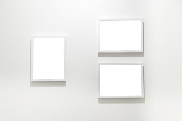 Empty frames on the wall in modern art museum gallery exhibition.