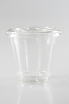 Empty full glass in white background