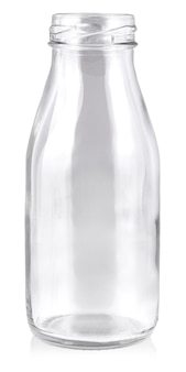 Empty glass bottle isolated on white wall.