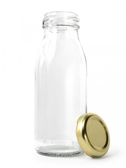 Empty glass bottle of milk with golden cap isolated on white background