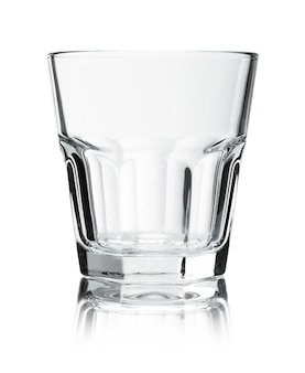 Empty glass for whiskey on white background.