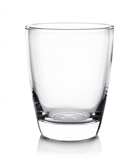 Empty glass on white wall