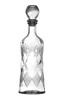 Empty glass wine decanter on a white background