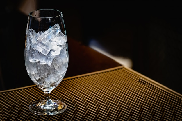 Empty glass with ice